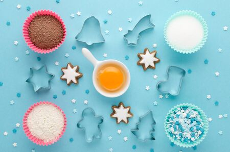 ingredients for baking and cookie cutter on blue background, flat lay Zdjęcie Seryjne