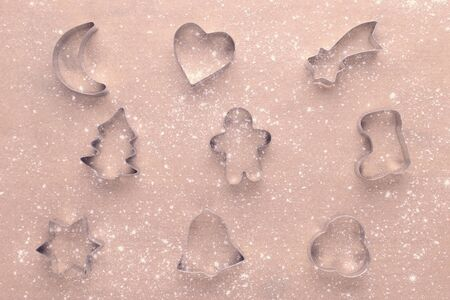 cookies cutter with flour on baking paper
