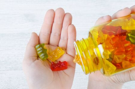 child holds vitamins for kids like jelly candy