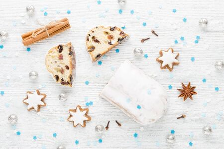 traditional german christmas cake stollen with cookies and decoration
