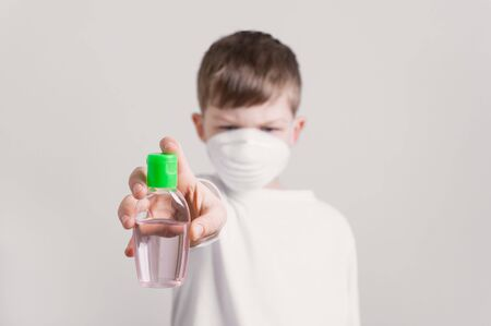 boy holds disinfectant gel in hand, virus prevention concept