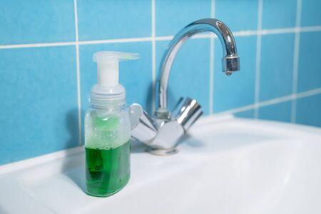 green liquid antibacterial soap in bathroom, closeup Stock fotó