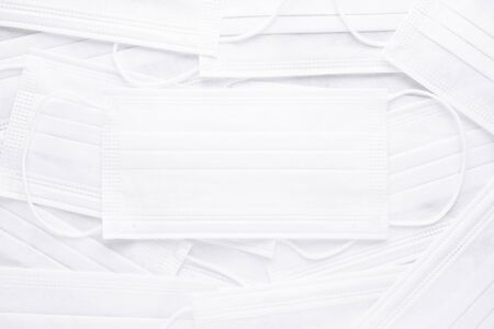 abstract background with many white medical masks, flat lay