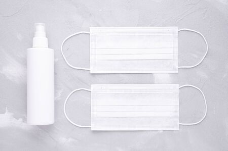 white medical masks and disinfect spray for virus protection