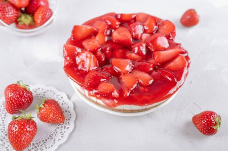cheesecake with strawberry and fresh berries on gray table, closeup Stok Fotoğraf