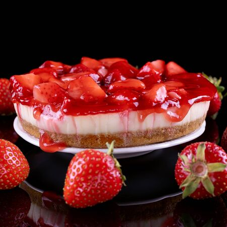 cheesecake with strawberry and fresh berries on black background Stok Fotoğraf