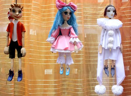 Three marionettes