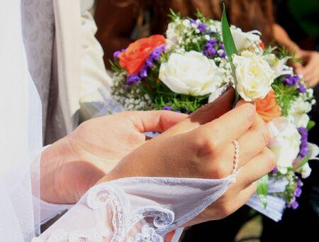boutonniere: bride holding boutonniere Stock Photo