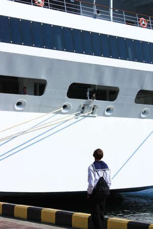 Seaman looking at big cruise ship photo