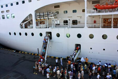 people about to board a ship Stock Photo