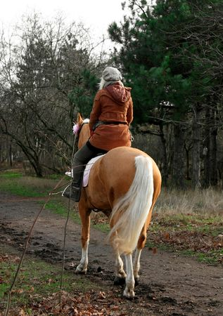 woman riding a horse photo