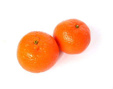 two ripe tangerine on white