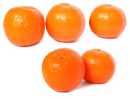 five ripe clementines isolated on a white back