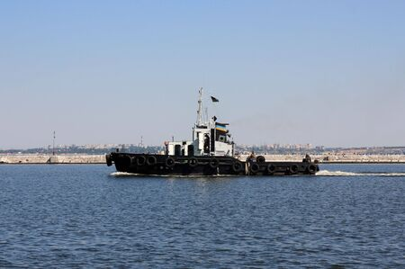 moving tugboat photo