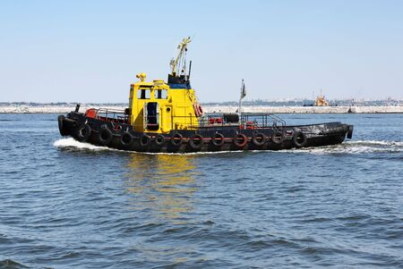 Tugboat: Tugboat underway at speed Stock Photo