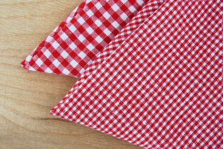 checkered napkins on wooden table photo