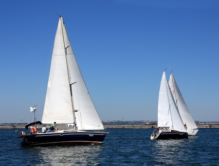 odessa: ODESSA,UKRAINE - MAY 28: Unidentified sailing boats compete during the ORT Media Group Cup Regatta on May 28, 2011 in Odessa, Ukraine