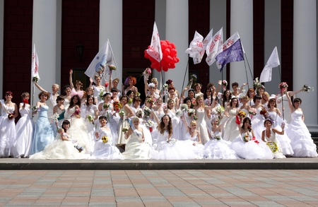 """ODESSA,UKRAINE – MAY 29: Annual event """" Bride Parade"""". Happy excited participants in fiancee's gowns take part in celebration of marriage and romance Bride Parade on May 29 , 2011 in Odessa,Ukraine  Stock Photo - 9638274"""