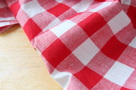 checkered tablecloth on wooden table photo