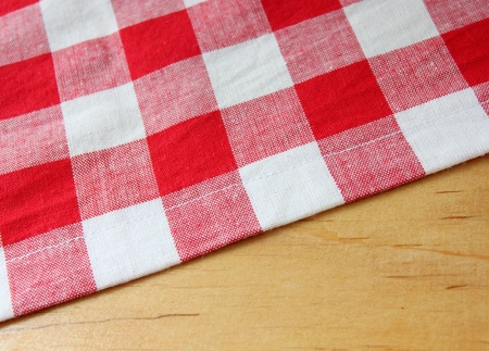 checker: red white towel on wooden table Stock Photo