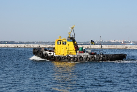 tug boat: tugboat at speed Editorial
