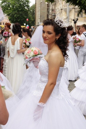 ODESSA,UKRAINE � MAY 27: Annual event � Bride Parade�. Happy excited participants in fiancee�s gowns take part in celebration of marriage and romance Bride Parade on May 27, 2012 in Odessa,Ukraine Stock Photo - 13795625