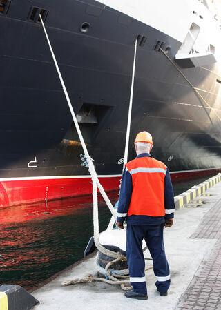 mooring: worker in harbour Stock Photo
