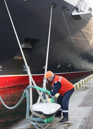 grapnel: worker in harbour Stock Photo