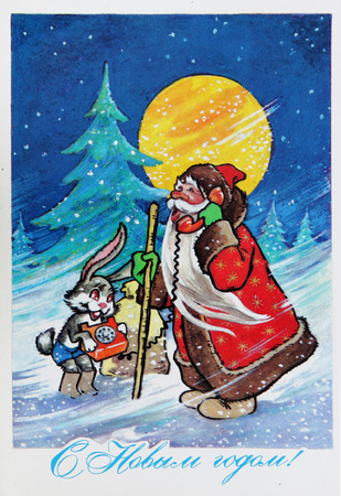 ded moroz: USSR-circa 1970s: Soviet postcard for Christmas shows Santa calling by phone and a hare , text in russian : Happy new year !