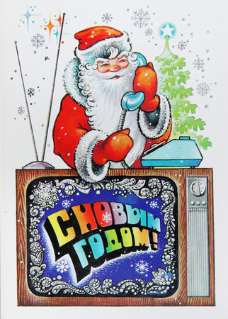 USSR-circa 1970s: Soviet postcard for Christmas shows Santa calling by phone , text in russian : Happy new year !