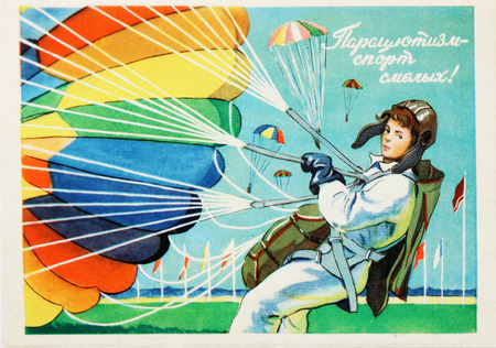 bailer: USSR-circa 1960s: Soviet postcard shows young parachutist , text in russian : Skydiving for brave