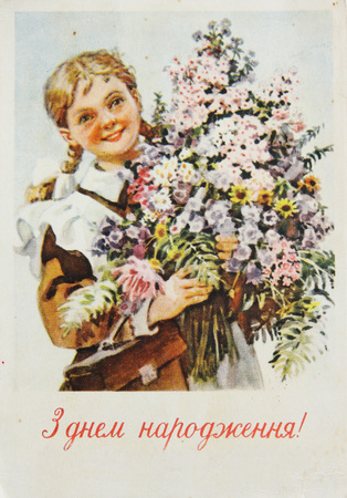 USSR-circa 1960s : Soviet postcard shows  a girl with bouquet of flowers , text in ukrainian Happy birthday Editorial