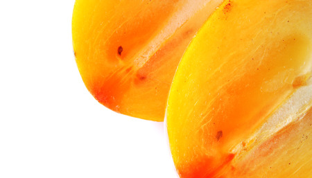 ripe sweet persimmon on white background