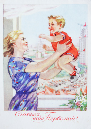 USSR-circa 1959 : Soviet postcard shows Mother with a baby devoted May day , text in russian Glore May day