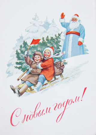 USSR-circa 1950s: Soviet postcard for Christmas shows happy children on sled and Santa  , text in russian : Happy new year !