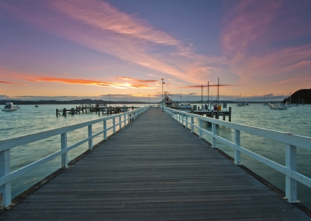 The view of wharf at Russell, New Zealand at dusk photo