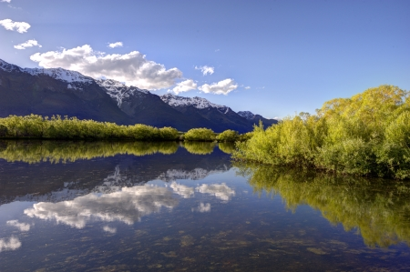 Reflection of the mountains on the lagoon at Glenorchy, New Zealand  Stock Photo