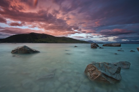 View from the shore of Lake Tekapo during dusk   Stock Photo
