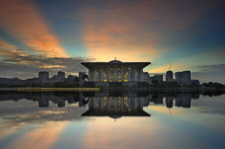 Known as  Steel Mosque , this image was taken during one sunny morning by the shore of Lake Putrajaya  Stock Photo