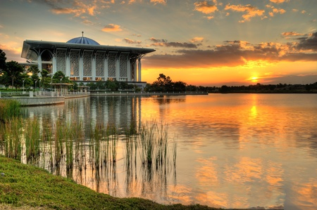 Mosque beside the lake at evening during sunset