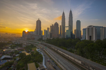 The view of sunrise over Kuala Lumpur city centre in the morning. Shot with Hitech GND0.6 filter. photo