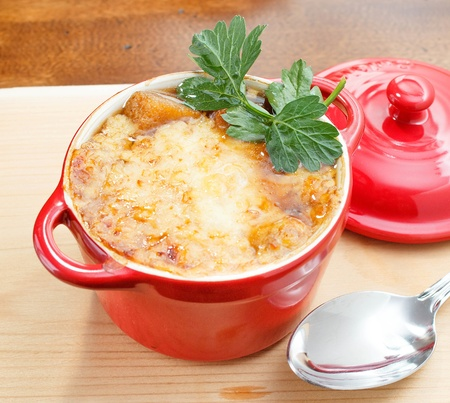 French onion soup in red pot photo