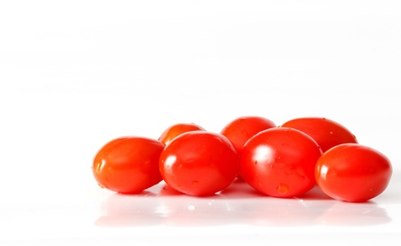 Closeup of grape tomatoes on white photo