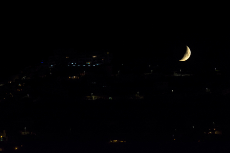 urbanized: A gibbous moon in September to close down over a hill urbanized Stock Photo