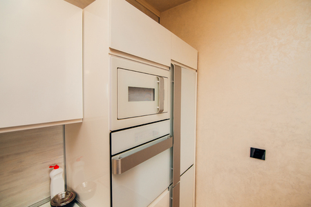 sink: Refrigerator in the kitchen. Home appliances for the kitchen.