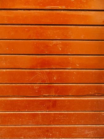 door handle: Old yellow, brown, red doors. Wood texture. Old shabby irradiated paint
