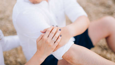 The hands of the newlyweds with rings. Wedding in Montenegro. Stock Photo