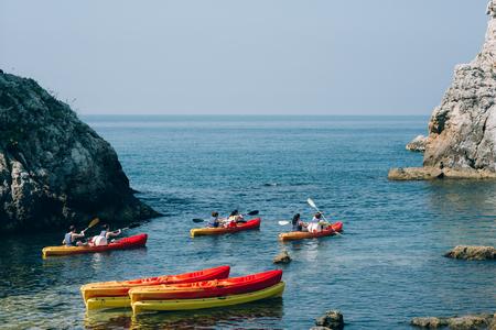 Kayaks at sea. Tourist kayaking in the sea near Dubrovnik, Croatia. Aerial Photo drone.