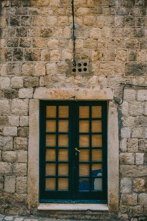 door handle: Old blue doors. Wood texture. Texture of metal. Old shabby, irradiated paint