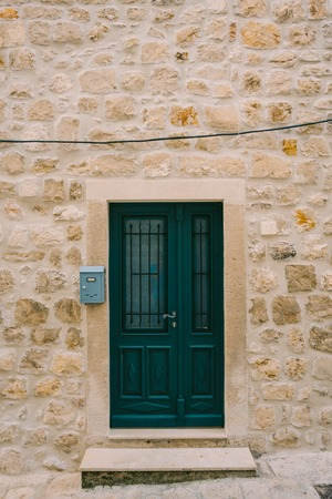 old english: Green doors. Wood texture. Old shabby, irradiated paint. Old wooden doors